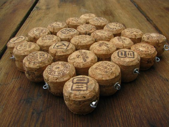 Champagne Cork Tops Trivet - I start by cutting each cork in half. I then drill holes through the sides so I can string them on galvanized wire that is secured with a loop and a grommet and the ends of each row