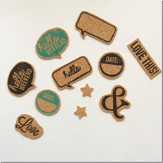 Make these yourself. Buy cork sheet, stamp away, cut out, glue on.