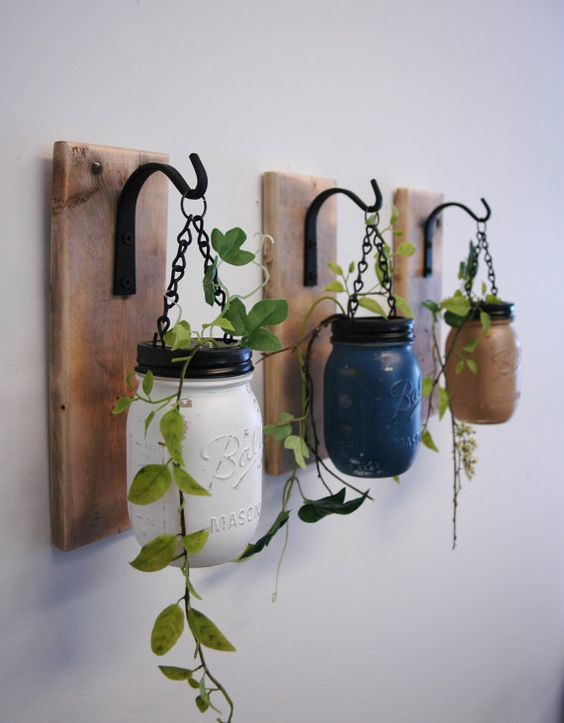decoracion de pared con botes