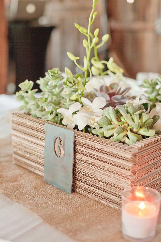 amazing little planter centerpiece made from layers of cardboard: