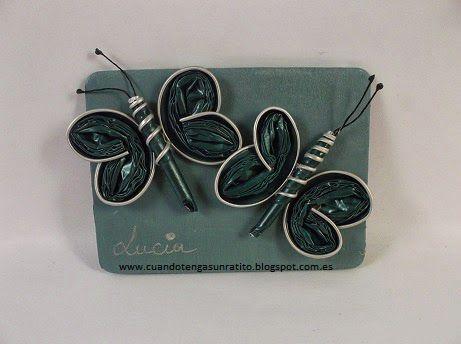 broche mariposa de capsulas