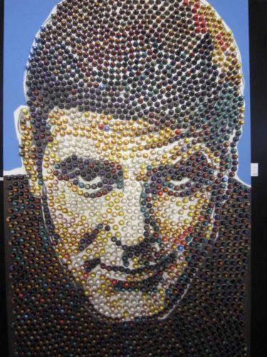 cuadro de pared con capsulas de cafe