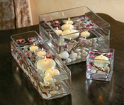 Centro de mesa con velas flotantes de guiaparadecorar.com