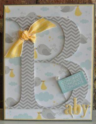Tarjeta en tonos grises y amarillos para Baby shower.