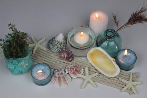 centro de mesa con conchas y caracolas